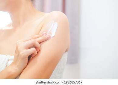 Woman applying natural cream, Woman moisturizing her arm with cosmetic cream, Spa and Manicure concept.