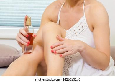 Woman Applying self Tanning Lotion