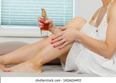 Woman Applying Self Tanning Lotion on her leg
