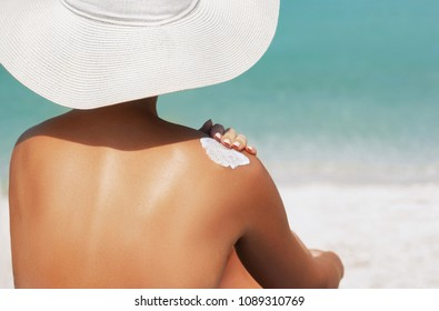 003519e72c675 Woman applying sunscreen creme on tanned shoulder. Skincare. Body Sun  protection suncream. Bikini