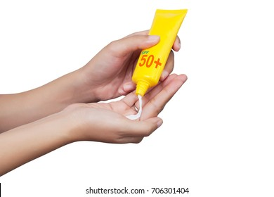 woman applying sunscreen on her hand isolated on white background with clipping path. SPF sunblock protection concept. Travel vacation