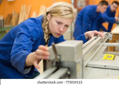 woman as apprentice for carpentry learning and working