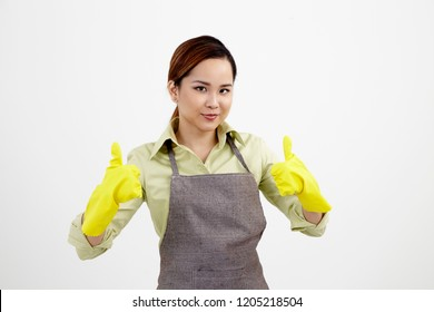 woman with apron wearing yellow rubber glove