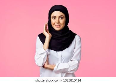 woman arab in black burqa on pink background