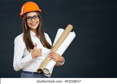 Woman architect show thumb up on black background. Smiling Businesswoman.