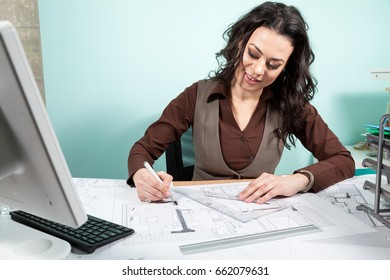 Woman architect working on blueprints. Working on new projects. Architecture and design