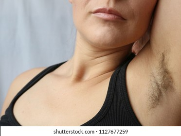 Woman with armpit hair, hair growth, depilation or new natural trend unshaved hair concept.