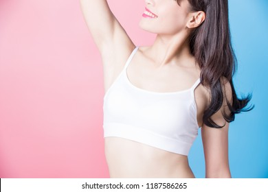 woman with armpit plucking on the blue background