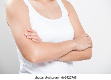 woman with arms crossed on white background