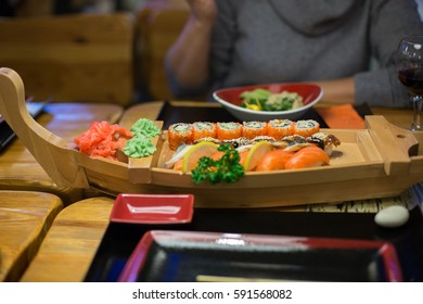 Woman arms keep sushi and other japanese food