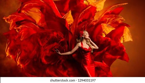Woman Art Fantasy, Dancing Fashion Model on Abstract Red Fabric Color Explosion Background