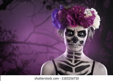 Woman art make up. Scary skull make-up for Halloween. Face-art body-art is painted, paints for body art cosmetics skin. Horror beauty nightmares.