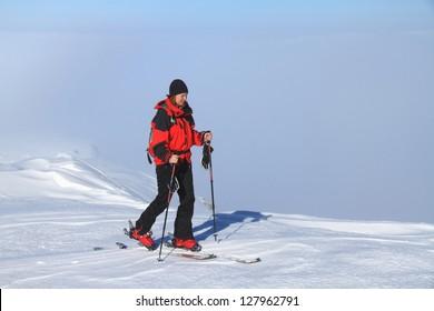 Woman ascending during ski touring in Tarcu mountains, Romania