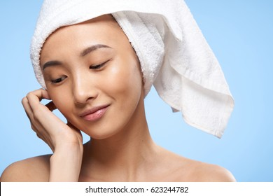 Woman asian with a towel on her head clean skin