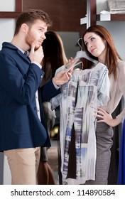 Woman asks her boyfriend to present her a dress