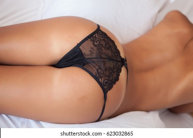 woman ass and back with black lingerie on bed