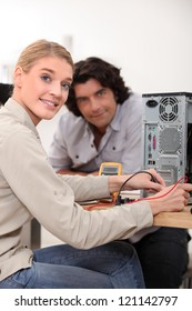 Woman assessing problem with computer