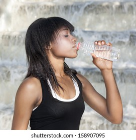 Woman athlete drinking water