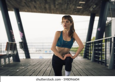 a woman athlete is performing stretching exercises