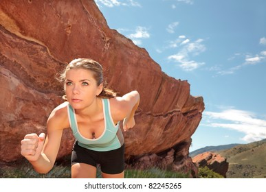 Woman athlete running in the mountains
