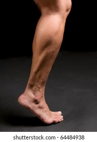 woman athlete's calf, ankle, and foot in action