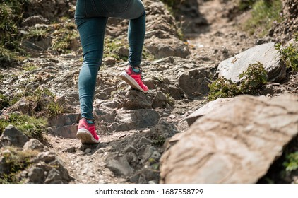 woman with an athletic pair of legs going for a run or running during sunrise or sunset up. Healthy lifestyle concept