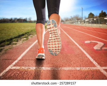 a woman with an athletic pair of legs going for a jog or run during sunrise or sunset - healthy lifestyle concept