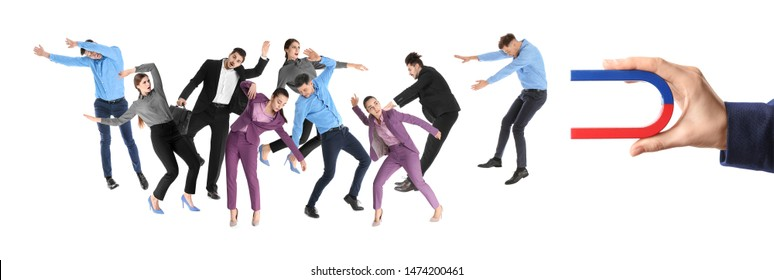 Woman attracting people with magnet on white background, closeup. Marketing concept