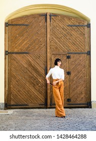 Woman attractive brunette wear fashionable clothes. Femininity and emphasize feminine figure. Girl makeup face wear loose high waisted pants. High waisted pants fashion trend. High waisted trousers.