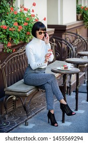 Woman attractive elegant brunette spend leisure cafe terrace background. Leisure concept. Girl fashionable lady with smartphone. Pleasant time and leisure. Relax and coffee break. Happy to hear you.