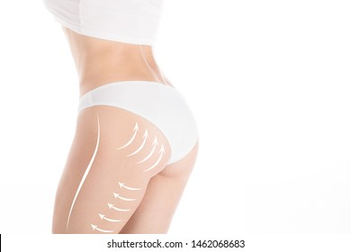 Woman attractive fit body and butt in base underwear. Lifting marking with arrows in female bum and hips, isolated on white. Plastic surgery, dieting, wellness, health, medicine, liposuction, lifting