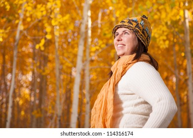 Woman in Autumn Forest of Aspen Trees