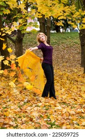 Woman with autumn leaves