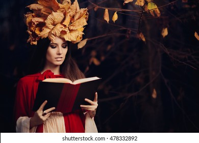 Woman With Autumn Leaves Crown Reading a Book - Portrait of a fall princess with foliage wreath