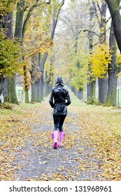 woman in autumnal alley