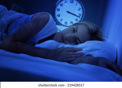 Woman awake early in the morning, having insomnia.