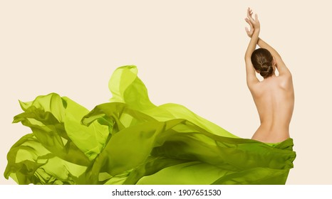 Woman Back Body Beauty. Slim Model in Green Flying Fabric. Organic Natural Herbal Cosmetic Care Concept. Rear View. Beige Background