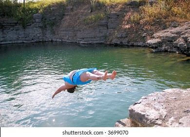 woman back diving into the water