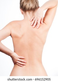 Woman from the back. Nude shoulders girl, naked body, pain concept