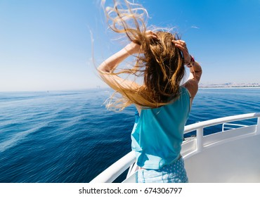 Woman back on yacht,looking to far