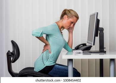 woman with backache in the office