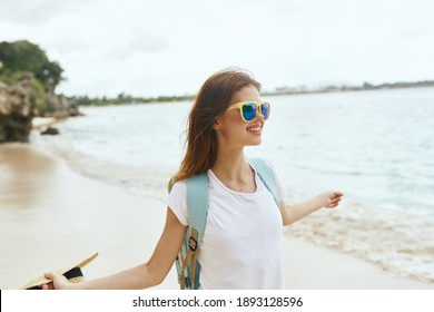 woman with backpack near the beach walk travel vacation island