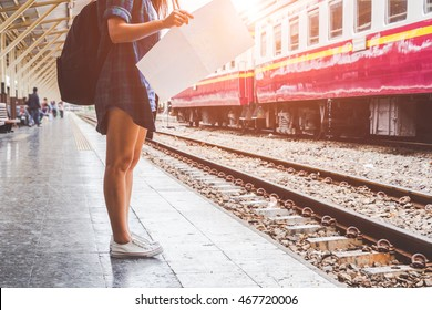 Woman and backpack in train station ,  The concept of travel and touris.