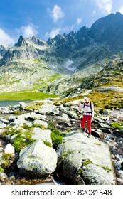 woman backpacker at Five Spis Tarns, Vysoke Tatry (High Tatras), Slovakia