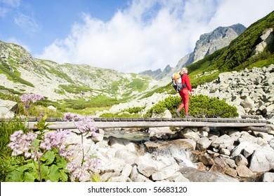 woman backpacker in Great Cold Valley, Vysoke Tatry (High Tatras), Slovakia
