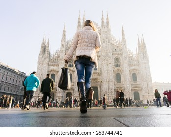 woman with bag in front of of Duomo di Milano (Milan Cathedral), Milan, Italy