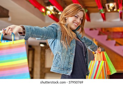 Woman with bags in a shopping center
