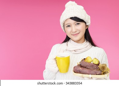 Woman with baked sweet potatoes
