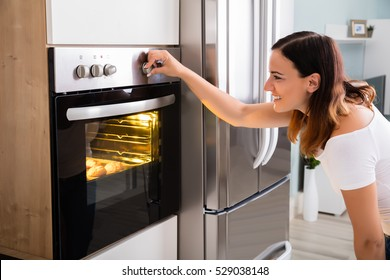 Woman Baking In Oven