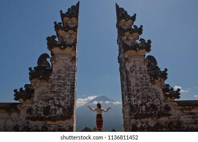 woman in bali gates volcano Agung
